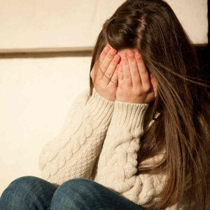 a young girl suffering from PTSD