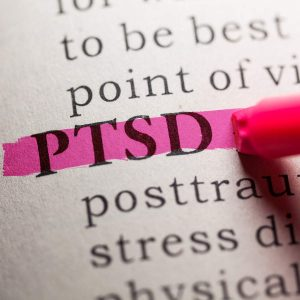 the word PTSD (post traumatic stress disorder) highlighted in pink