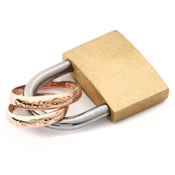wedding rings for marriage locked inside a padlock