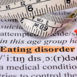 the word eating disorder highlighted with a tape measure above it