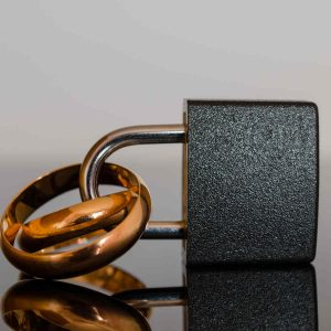 rings in a padlock signifying forced marriage