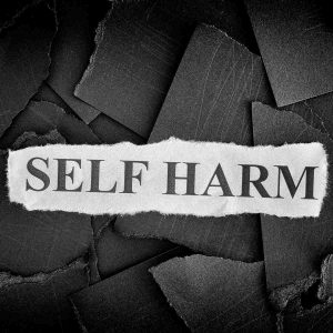 self-harm written in black and white