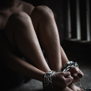 a young person's arms tied up in chains signifying the dangers of CSE and sexually harmful behaviour