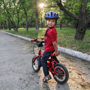 a young boy on a bike looking back at the responsibilities of trustees in safeguarding