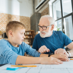 an elderly man and child discussing education